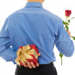 Man with a gift box and a rose — Stock Photo #4851888