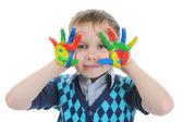 Lächelnde junge mit den handflächen gemalt von farbe. — Stockfoto