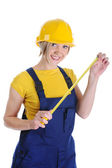 Girl the builder in a yellow helmet — Stock Photo