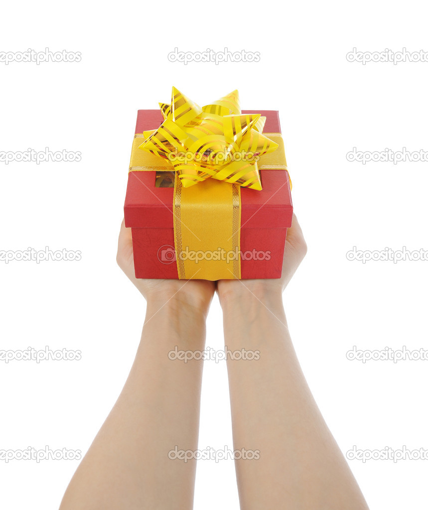 Box with a gift in the hands of women. Isolated on white background — Stock Photo #4962392