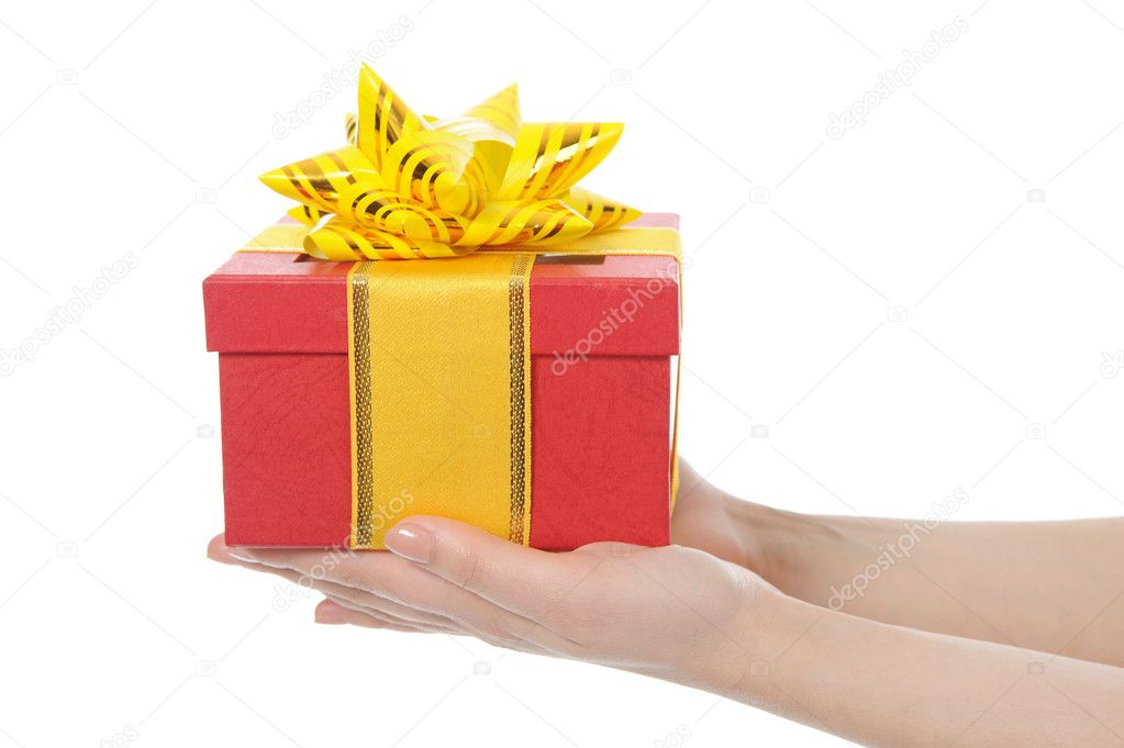 Box with a gift in the hands of women. Isolated on white background — Stock Photo #4962393