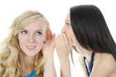 Two beautiful women telling secret — Stock Photo