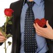 Man with a gift box and a rose — Stock Photo
