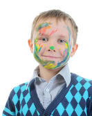 Boy with paint stained face — Stock Photo