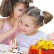 Beautiful little girl celebrates birthday - Stock Photo