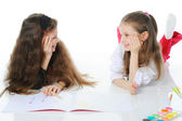 Two sisters draw on the album. — Stock Photo