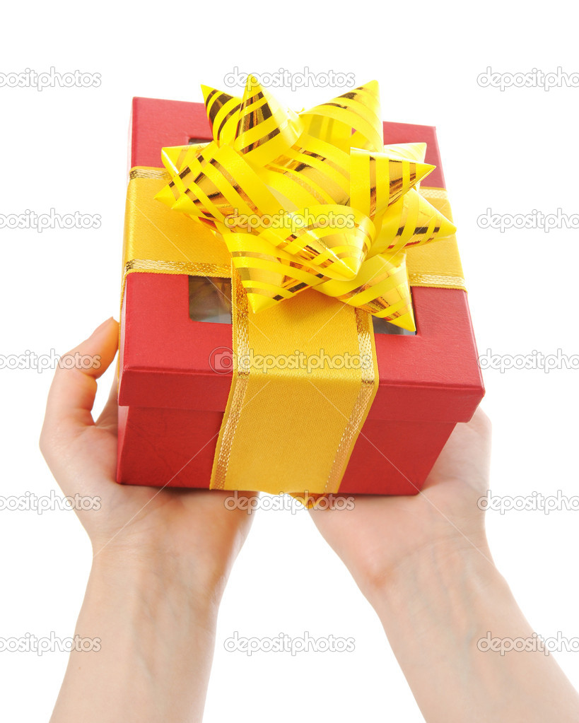 Box with a gift in the hands of women. Isolated on white background — Stock Photo #5203790