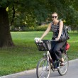 Woman on bicycle smiling. — Stock Photo