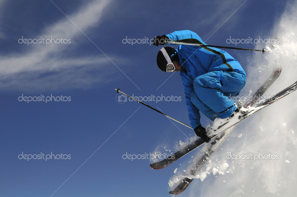 Skier jumping with crossed skis on a dark-blue sky background. — Stock Photo #3219871