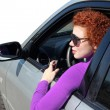 Royalty-Free Stock Photo: Woman driving her new car