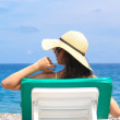 Woman relaxing at the beach — Stock Photo #3356552