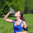 Runner stops to drink a water — Stock Photo