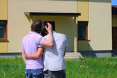 Same-sex couple next to their new house — Stock Photo