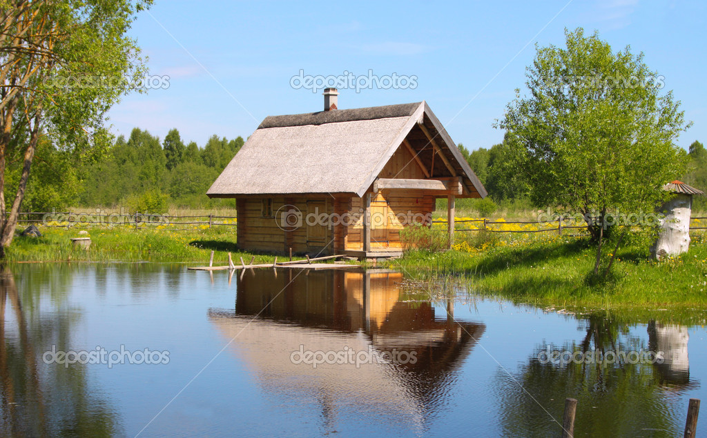 Countryside House At The Lake Stock Photo