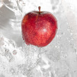 Fresh an apple in streaming water. — Stock Photo