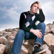 Young man on the rocks — Stock Photo