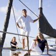 Teenage girl and parents on sailboat - Stock Photo