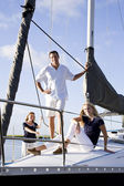 Teenage girl and parents on sailboat — Stock Photo