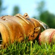Stock Photo: Old glove and baseball