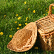 Summer hat and wicker basket — Stock Photo