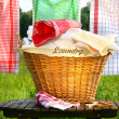 Laundry basket on rustic table — Stock Photo