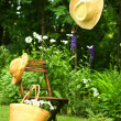 Straw hat hanging on clothesline - Stock Photo