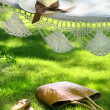 Straw hat with brown ribbon on hammock — Stok Fotoğraf #3245968