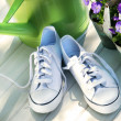 White tennis running shoes - Stock Photo