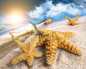 Message in a bottle buried in sand — Stock Photo