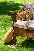 Wicker chair on the grass — Photo