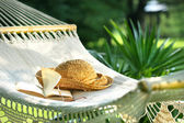 Hammock, book, hat, and glasses — Stock Photo