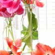 Spring tulips in old milk bottles — Stock Photo