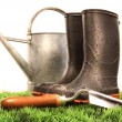 Garden boots with tool and watering can — Stok fotoğraf
