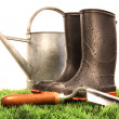 Royalty-Free Stock Photo: Garden boots with tool and watering can
