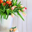 Spring tulips on an old bench — Stock Photo