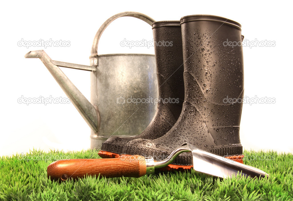 Garden boots with tool and watering can stock photo for Gardening tools list 94