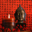 Asian candle with red orential background — Stock Photo