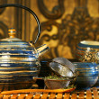 Blue oriental teapot with cups — Stock Photo