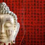 Buddha head and incense — Stock Photo
