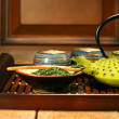 Green cast iron teapot - Stock Photo