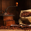 Antique coffee grinder with beans - Stok fotoğraf