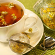 Chamomile  tea with white tea cup - Stock Photo