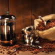 Stock Photo: Sack of coffee beans with french press