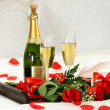 Romantic evening with champagne - Stock Photo