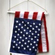 American flag folded with clothes hanger - Stock Photo