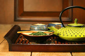 Green cast iron teapot — Stock Photo
