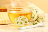 Glass tea cup with herbal tea — Stock Photo