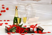 Champagne in bed — Stock Photo
