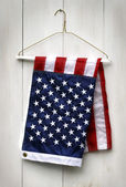 American flag folded with clothes hanger — Стоковое фото