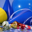 Blue party decorations with balloons,hats and ribbons — Stock Photo